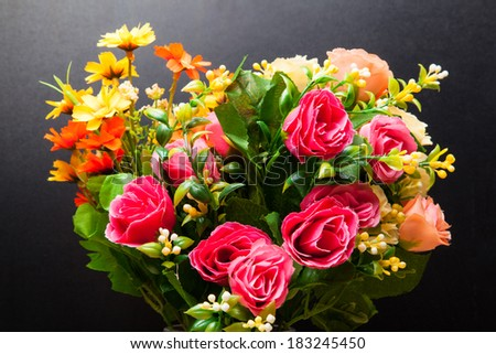 Beautiful bouquet of bright flowers on the black backdrop - stock photo