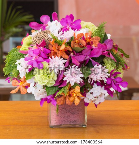 beautiful bouquet of bright flowers  on wooden table - stock photo