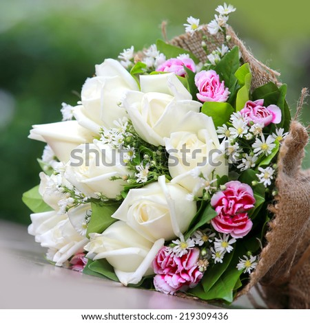 Beautiful Bouquet Of Bright White Rose Flowers On Table With Green Background