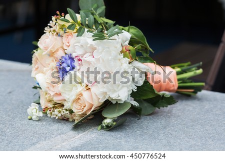 beautiful bouquet of bright white rose flowers, on table with grey background - stock photo