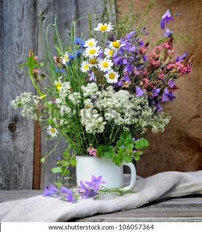 Beautiful bouquet of bright wildflowers - stock photo