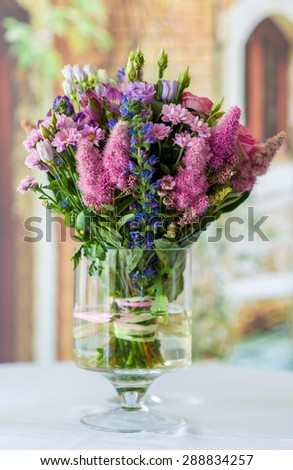 Beautiful bouquet of bright wildflowers in a wase