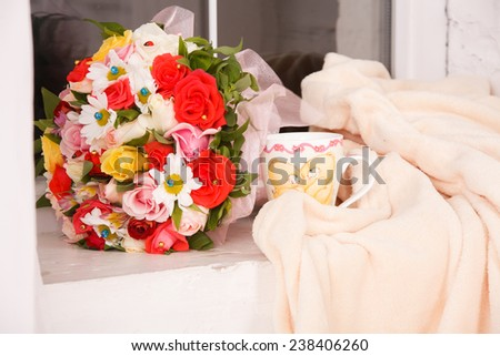 beautiful bouquet of bright wildflowers on a window sill - stock photo