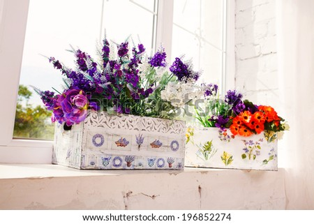 beautiful bouquet of bright wildflowers on a wooden window sill - stock photo