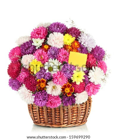 Beautiful bouquet of chrysanthemums in wicker basket isolated on white - stock photo