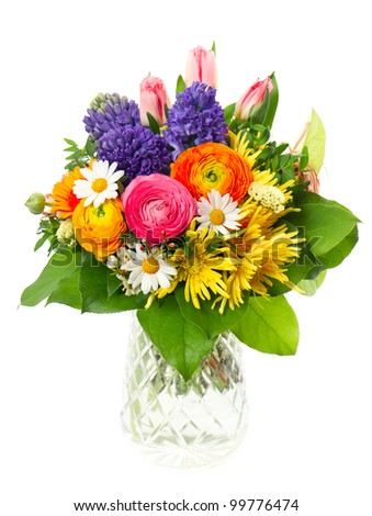 beautiful bouquet of colorful spring flowers in a glass vase. tulip, ranunculus, hyacinth, daisy, gerber - stock photo