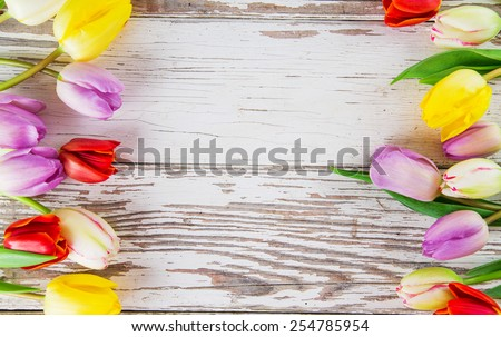 Beautiful bouquet of colorful tulips flowers on wooden table, close-up. - stock photo