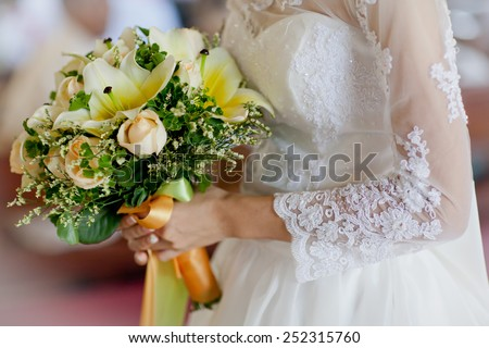 Beautiful bouquet of flowers in bride Hand - stock photo