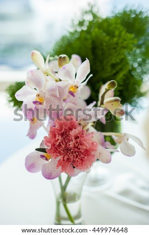 Beautiful bouquet of flowers in vase on window background, Vase full of colorful flowers for home decoration on the table. Decorate object for valentine day.  image in natural light select focus - stock photo