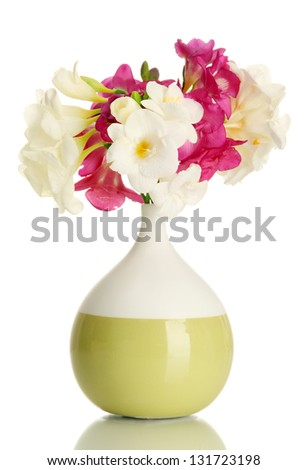 Beautiful bouquet of freesias in vase, isolated on white - stock photo