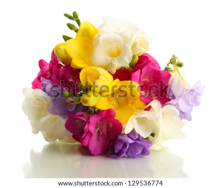 Beautiful bouquet of freesias, isolated on white - stock photo
