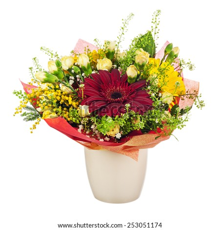 Beautiful bouquet of gerbera, carnations and other flowers in red package and vase isolated on white background.