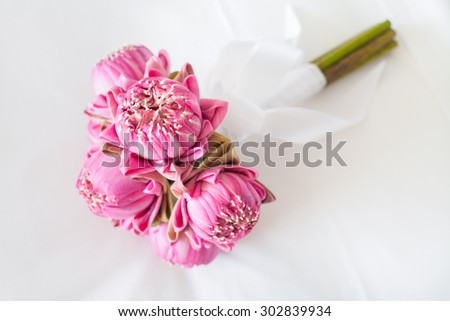 Beautiful bouquet of lotuses set for wedding day - stock photo