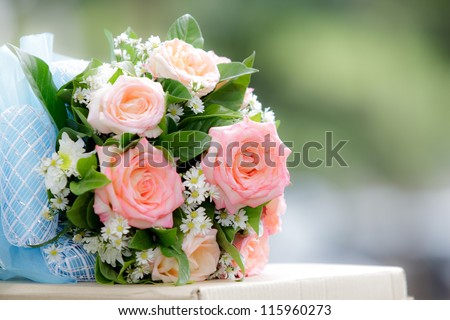 beautiful  bouquet of pink roses before wedding
