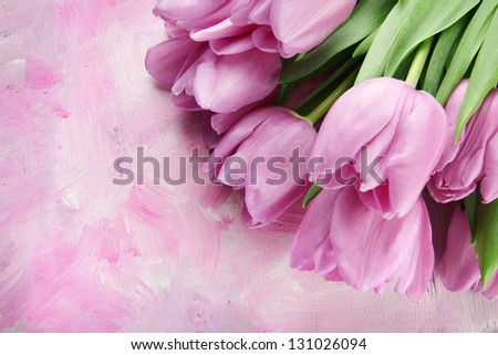 Beautiful bouquet of purple tulips on pink wooden background - stock photo