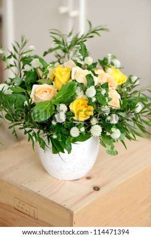 Beautiful bouquet of roses and margaritas flowers in a vase - stock photo