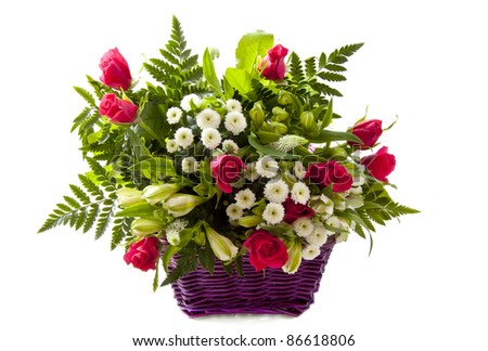 Beautiful bouquet with pink roses in a purple basket over white