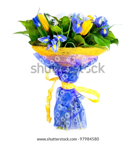 Beautiful bouquet with tulips and irises - stock photo