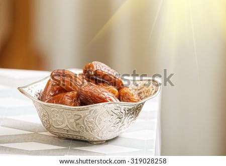 Beautiful bowl full of date fruits symbolizing Ramadan - stock photo