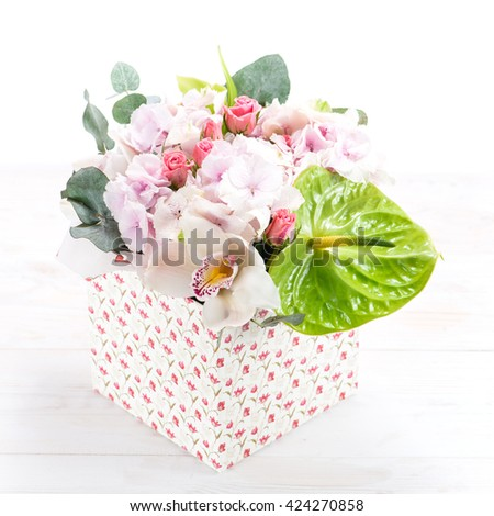 beautiful box delicate exotic flower (hydrangea, anthurium, shrub rose and orchid) - stock photo