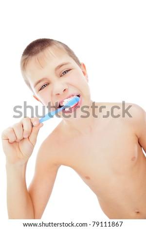 Beautiful boy brushing teeth, isolated on white - stock photo