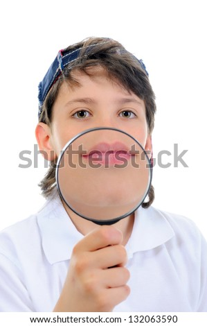 Beautiful boy looking through a magnifying glass isolated on a white background - stock photo