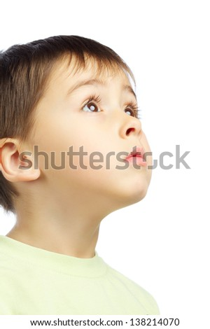 beautiful boy looking up, isolated on white - stock photo