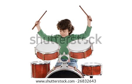 Beautiful boy playing the drums on a white background - stock photo