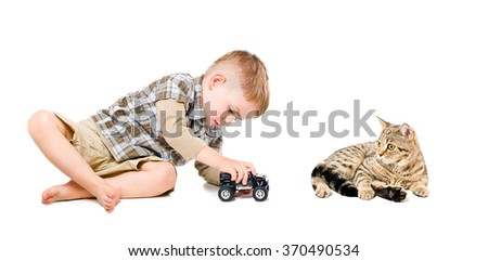 Beautiful boy playing toy car together with cat isolated on white background - stock photo