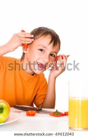 beautiful boy prepares breakfast vegetable on a white
