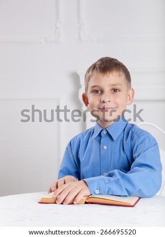 beautiful boy reading a book - stock photo