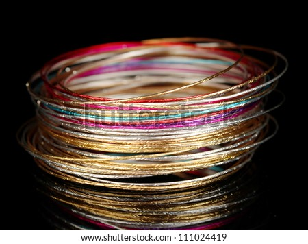 Beautiful bracelet isolated on black background