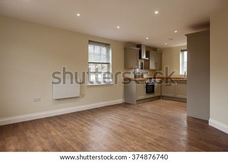 beautiful brand new apartment open plan living roomkitchen with wooden flooring and built