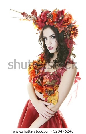 Beautiful Brazilian model in shades of Autumn.  Shot on white Background. - stock photo
