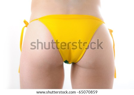 Beautiful Brazilian model wearing a green and yellow soccer thong bikini bottom isolated over white background