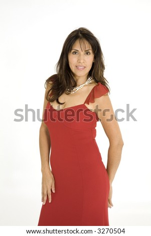 Beautiful Brazilian or Hispanic woman in a red evening gown on a white background