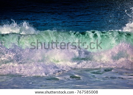 Beautiful breaking ocean wave with  aqua and blue colors .