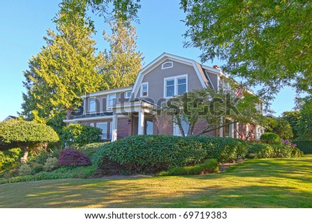 Beautiful brick  home up the hill - stock photo