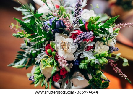 beautiful bridal bouquet and rings - stock photo