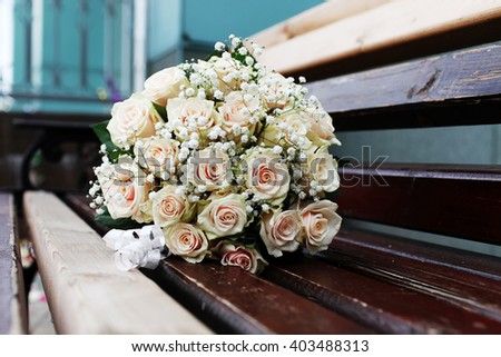 Beautiful bridal bouquet of flowers on the bench