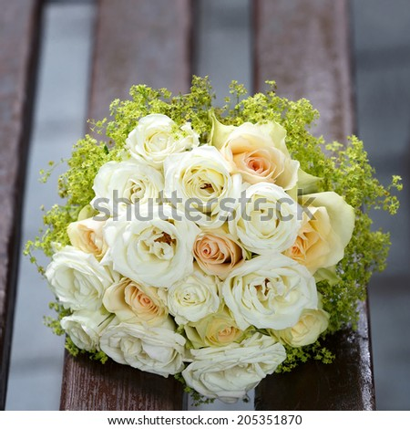 beautiful bridal bouquet of lilies and roses at a wedding party