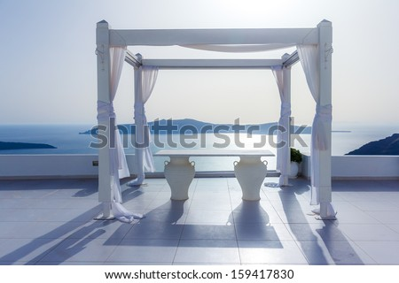 Beautiful bridal decoration on top of a roof garden at Oia, Santorini, Greece - stock photo