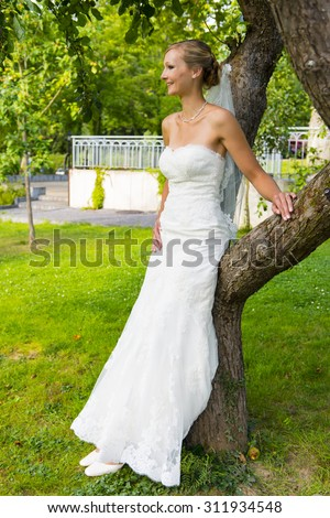 beautiful bride after wedding ceremony - stock photo