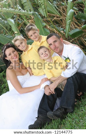 beautiful bride and family - stock photo