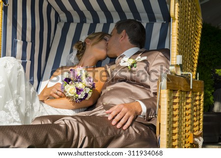 beautiful bride and groom after wedding ceremony - stock photo