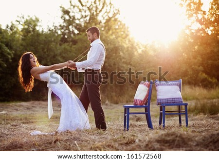 Beautiful bride and groom portrait in nature - stock photo