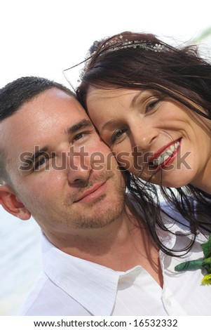 beautiful bride and husband headshot angle - stock photo