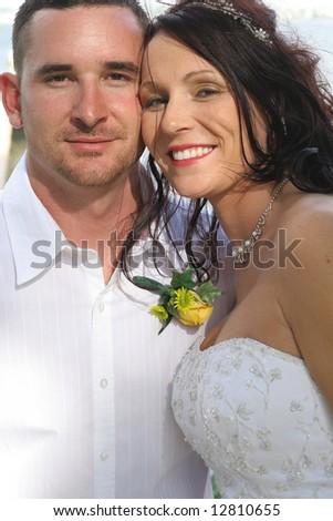 beautiful bride and husband headshot vertical - stock photo