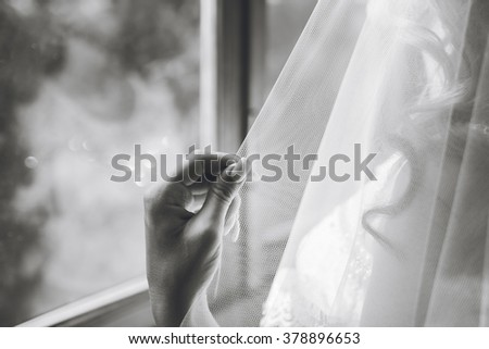 beautiful bride at a window at home