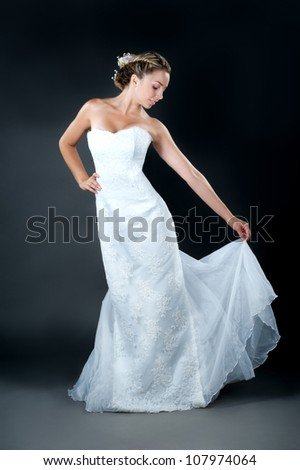 beautiful bride blond girl in white wedding dress with hairstyle and bright makeup - stock photo